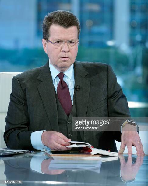 """Fox anchor Neil Cavuto interviews former Ohio Governor John Kasich """"Your World With Neil Cavuto"""" at Fox News Channel Studios on October 15, 2019 in..."""