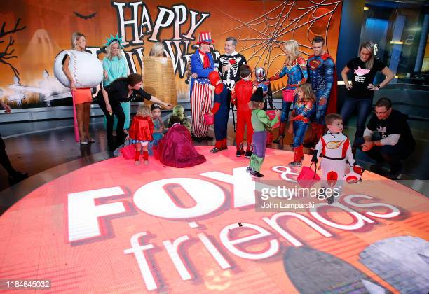 Fox anchors Carley Shimkus Janice Dean Ainsley Earhardt Steve Doocy Ed Henry Pete Hegseth Jennifer Rauchet and children participate in Fox Friends...