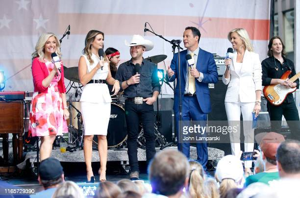 Fox anchors Janice Dean Jillian Mele Brian Kilmeade and Ainsley Earhardt join Justin Moore on stage during FOX Friends AllAmerican Summer Concert...