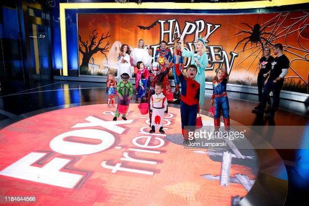 Fox anchors Jedediah Bila Carley Shimkus Pete Hegseth Jennifer Rauchet Janice Dean and children participate in Fox Friends Halloween Celebration at...