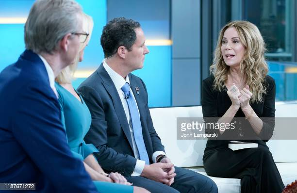 """Fox anchors Steve Doocy, Ainsley Earhardt and Brian Kilmeade interview Kathie Lee Gifford during """"Fox & Friends"""" at Fox News Channel Studios on..."""