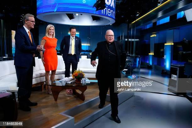 "Fox anchors Steve Doocy, Ainsley Earhardt and Brian Kilmeade join Cardinal Timothy Dolan during ""Fox & Friends"" at Fox News Channel Studios on..."