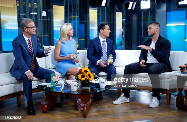 Fox anchors Steve Doocy Ainsley Earhardt Jillian Mele and Brian Kilmeade are joined by Professional baseball player Tim Tebow during Fox Friends at...