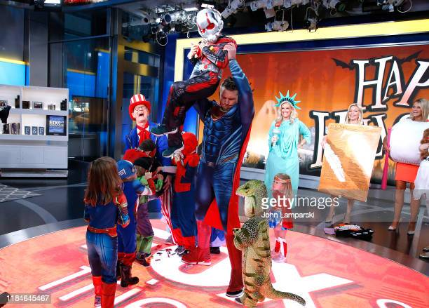 Fox anchors Steve Doocy Janice Dean Ainsley Earhardt Carley Shimkus Pete Hegseth and children participate in Fox Friends Halloween Celebration at Fox...