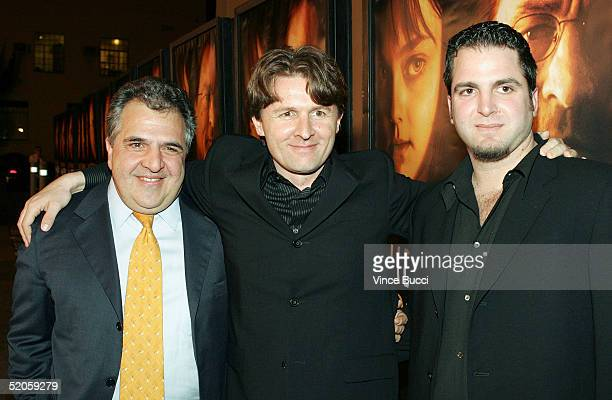 Fox executive Jim Gianopulos director John Polson and writer Ari Schlossberg attend the Twentieth Century Fox film premeire Hide and Seek on January...