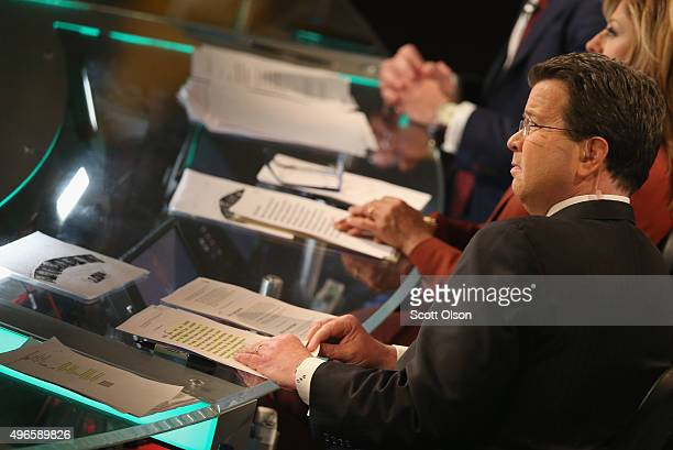 Fox moderator Neil Cavuto pauses during the Republican Presidential Debate sponsored by Fox Business and the Wall Street Journal at the Milwaukee...