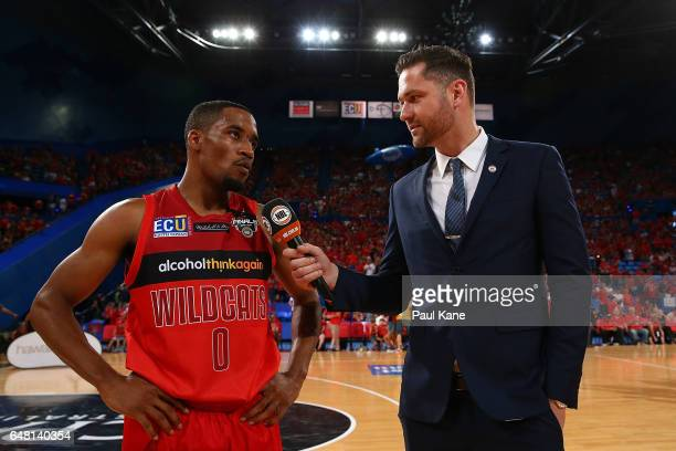 Fox NBL commentator Tommy Greer talks with Bryce Cotton of the Wildcats at the half time break during game three of the NBL Grand Final series...