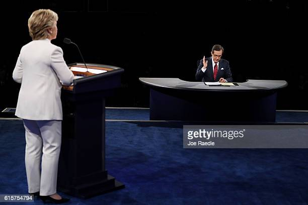 Fox News anchor and moderator Chris Wallace asks Democratic presidential nominee former Secretary of State Hillary Clinton a question during the...