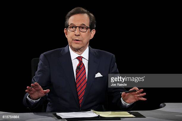 Fox News anchor and moderator Chris Wallace asks the candidates a question during the third US presidential debate at the Thomas Mack Center on...
