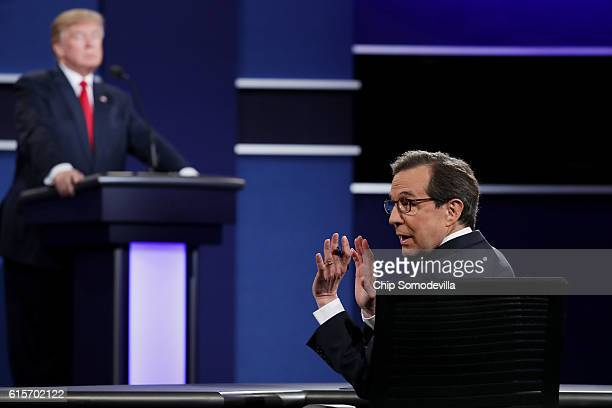 Fox News anchor and moderator Chris Wallace quiets the audience during the third US presidential debate at the Thomas Mack Center on October 19 2016...