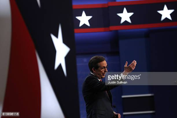 Fox News anchor and moderator Chris Wallace speaks before the start of the third US presidential debate with republican presidential nominee Donald...