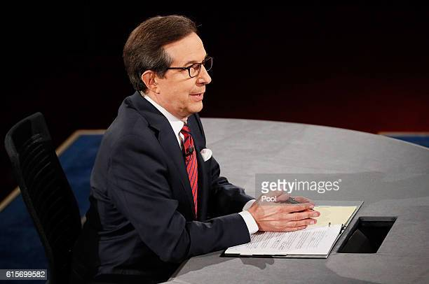 Fox News anchor and moderator Chris Wallace speaks to candidates during the third U.S. Presidential debate at the Thomas & Mack Center on October 19,...