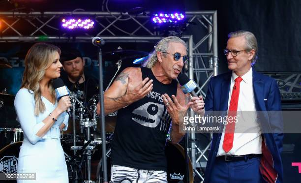 Fox News anchor Jillian Mele and Steve Doocy stand on stage with Dee Snider before he performs on FOX Friends on July 20 2018 in New York City