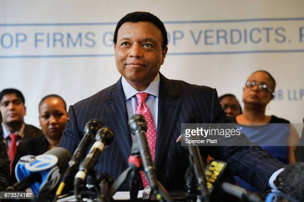 Fox News anchor Kelly Wright speaks to the media as he joins other current and former Fox employees at a press conference organized by his attorney...