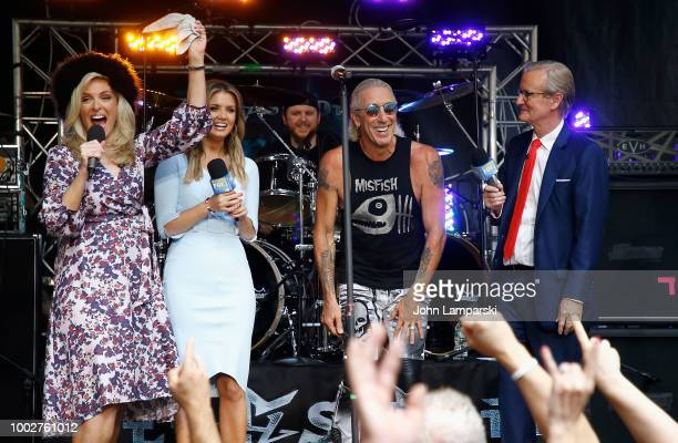 Fox News anchors Janice Dean Jillian Mele and Steve Doocy stand on stage with Dee Snider before he performs on FOX Friends on July 20 2018 in New...