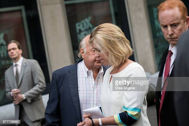 Fox News chairman Roger Ailes tries to avoid the camera as he walks with his wife Elizabeth Tilson and security detail as they leave the News Corp...