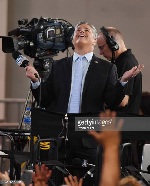 Fox News Channel and radio talk show host Sean Hannity reacts to attendees before a Donald Trump campaign rally at the Las Vegas Convention Center on...