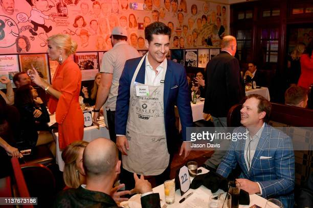 Fox News commentator Jesse Watters chats with guest during Waiting for Wishes Celebrity Waiters Dinner hosted by Kevin Carter Jay DeMarcus on April...
