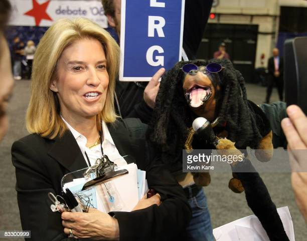 Fox News correspondent Greta Van Susteren gets interviewed by Triumph the comic insult dog inside the media center during the third 2008 Presidential...