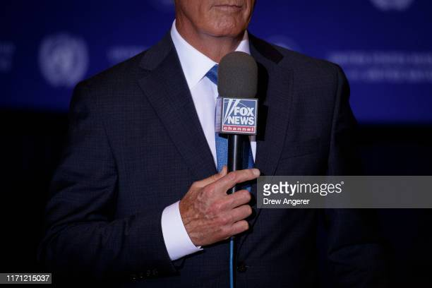 Fox News correspondent works before President Donald Trump's arrival at a press conference on the sidelines of the United Nations General on...