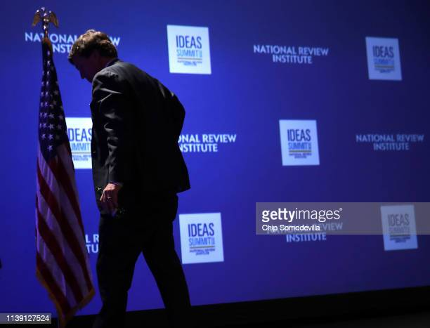 Fox News host Tucker Carlson leaves the stage after talking about 'Populism and the Right' during the National Review Institute's Ideas Summit at the...