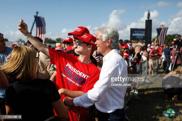 Fox News journalist John Roberts takes photos with supporters of President Donald Trump after he gave a campaign speech just four days before...
