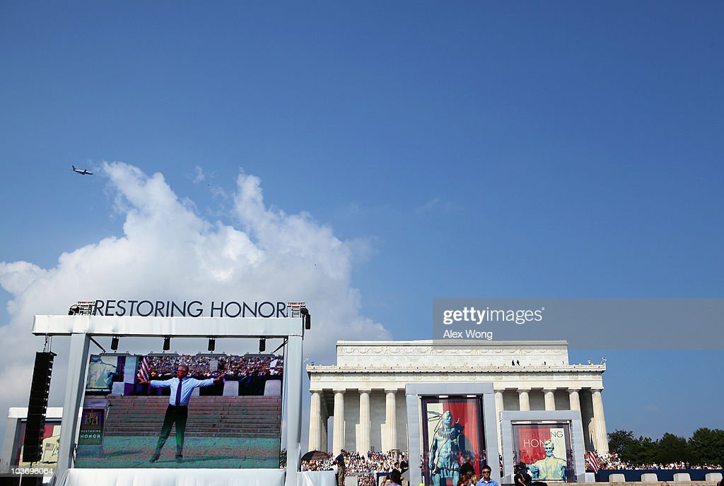 Fox News personality Glenn Beck is seen on a big monitor during the 'Restoring Honor' rally in front of the Lincoln Memorial at the National Mall on August 28, 2010 in Washington, DC. Beck held the rally on the 47th anniversary of the 'I Have a Dream' speech of Dr. Martin Luther King Jr. to 'restore America.'