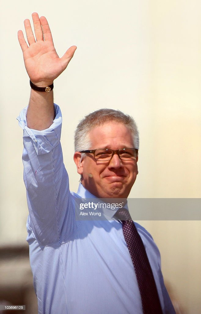 Fox News personality Glenn Beck waves during the 'Restoring Honor' rally in front of the Lincoln Memorial at the National Mall on August 28, 2010 in Washington, DC. Beck held the rally on the 47th anniversary of the 'I Have a Dream' speech of Dr. Martin Luther King Jr. to 'restore America.'