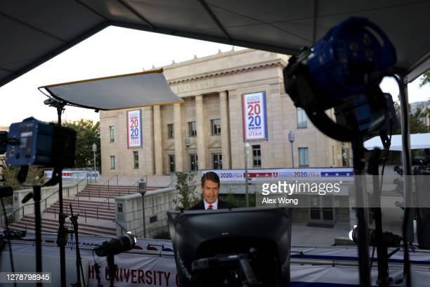 Fox News reporter Griff Jenkins participates in a live shot outside the vice presidential debate hall at Kingsbury Hall of the University of Utah...