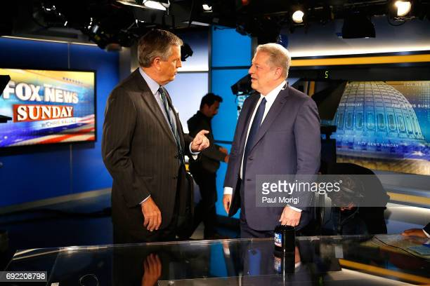 Fox News Senior Political Analyst Brit Hume talks with former Vice President Al Gore on the set of Fox News Sunday with Chris Wallace at FOX News DC...