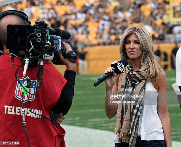 Fox NFL sideline reporter Laura Okmin reports from the sideline during a National Football League game between the Tampa Bay Buccaneers and the...