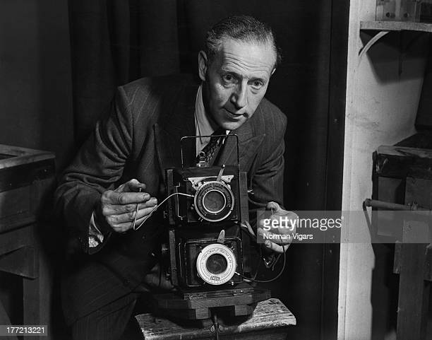 Fox Photos photographer Reg Speller with the double camera he will use at the coronation of Queen Elizabeth II 29th May 1953