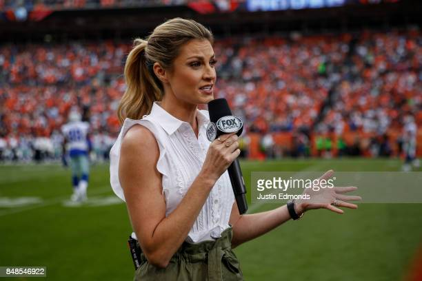 Fox sideline reporter Erin Andrews works on the sideline during a game between the Denver Broncos and the Dallas Cowboys at Sports Authority Field at...