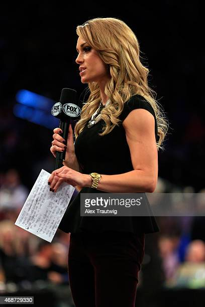 Fox sideline reporter Molly McGrath on the air during a quarterfinal game of the Big East basketball tournament between St John's and Providence at...