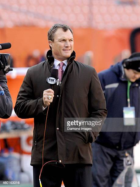 Fox Sports analyst John Lynch watches warm ups on the field prior to a game between the Indianapolis Colts and the Cleveland Browns on December 7...
