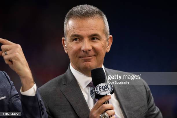 Fox Sports analyst Urban Meyer on the sidelines before the Big 10 Championship game between the Wisconsin Badgers and Ohio State Buckeyes on December...