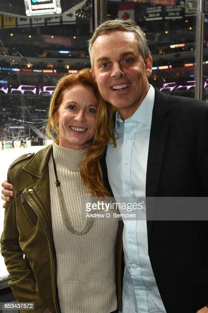 Fox Sports Broadcaster Colin Cowherd poses for a photo with his wife Ann Cowherd during a game between the Los Angeles Kings and the Arizona Coyotes...