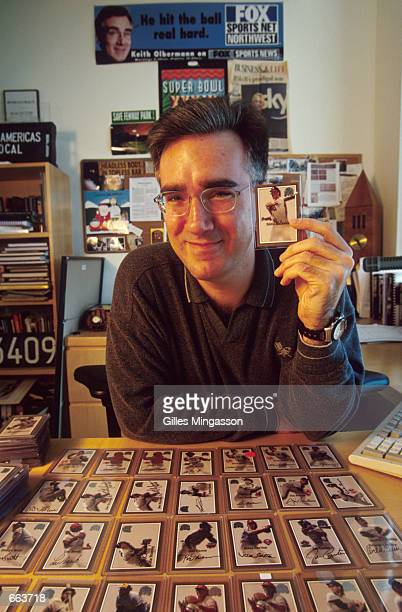 Fox Sports broadcaster Keith Olbermann poses with his autographed baseball card collection May 2 2000 in Santa Monica CA