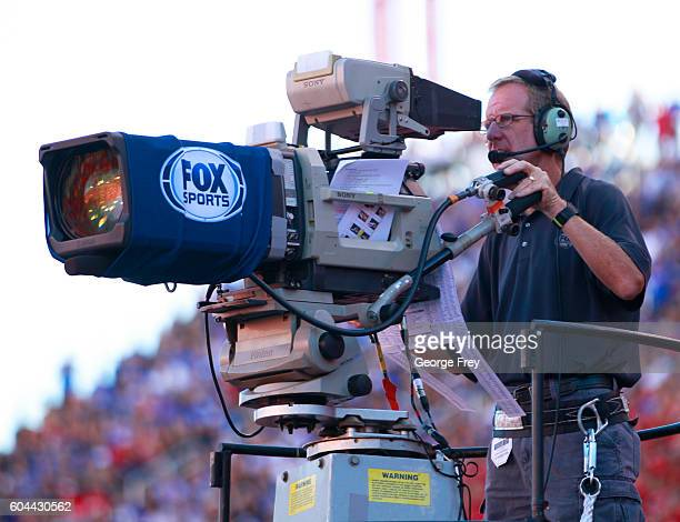 Fox Sports cameraman records the game against the Utah Utes and Brigham Young Cougars during the first half of an college football game at Rice...