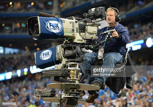 Fox Sports cameraman runs a TV camera during the game between the Detroit Lions and the Chicago Bears at Ford Field on October 18 2015 in Detroit...