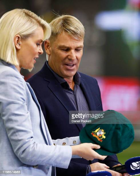 Fox Sports commentator Sarah Jones and Shane Warne, with his baggy green cap which has been sold for more than $1 million, with all funds going to...