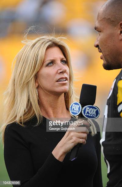 Fox Sports National Football League sideline reporter Laura Okmin interviews linebacker James Farrior of the Pittsburgh Steelers after a game against...