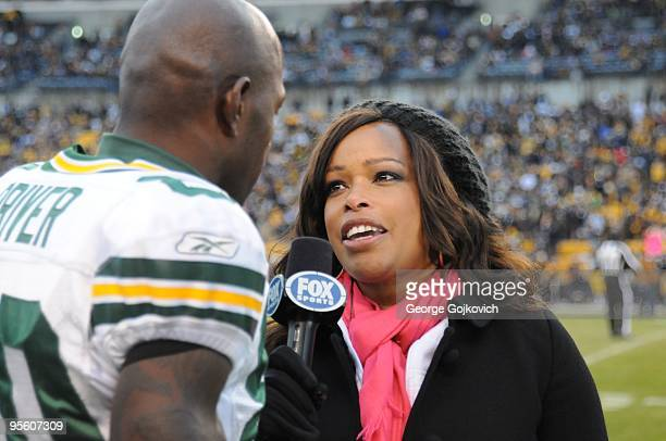 Fox Sports National Football League sideline reporter Pam Oliver interviews wide receiver Donald Driver of the Green Bay Packers before a game...