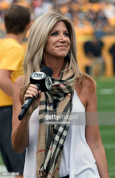 Fox Sports NFL sideline reporter Laura Okmin looks on from the sideline during a National Football League game between the Tampa Bay Buccaneers and...