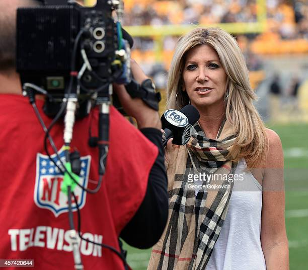 Fox Sports NFL sideline reporter Laura Okmin reports from the sideline during a National Football League game between the Tampa Bay Buccaneers and...