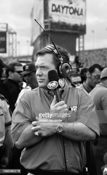 Fox Sports television broadcaster Matt Yocum prepares to talk with race drivers prior to the start of the 2002 Daytona 500 stock car race at Daytona...