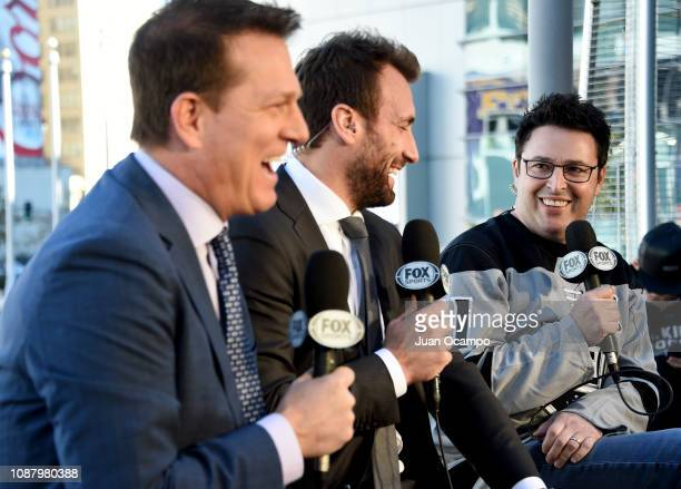 Fox Sports West broadcasters Patrick O'Neal and Jarret Stoll talk with Executive producer of 'The Ellen Show' Andy Lassner during the Los Angeles...