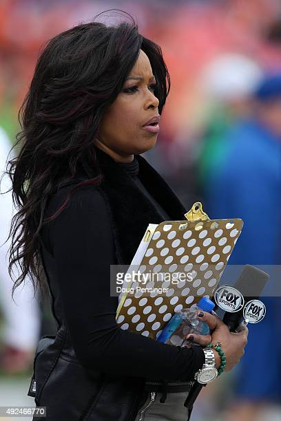 Fox televison sideline reporter Pam Oliver watches the action as the Minnesota Vikings face the Denver Broncos at Sports Authority Field at Mile High...