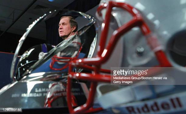 Foxboro, MA - Framed by the Lamar Hunt AFC Championship trophy, New England Patriots head coach Bill Belichick speaks to the media at Gillette...