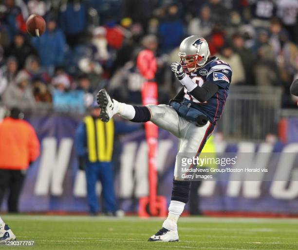 Foxboro, MA - New England Patriots quarterback Tom Brady punts on 3rd down in the fourth quarter of a 45-10 victory over the Denver Broncos in the...